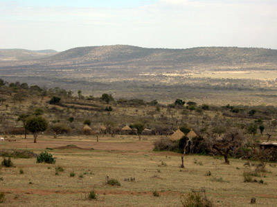 View over Maasai <em>bomas</em> and towards the disputed land