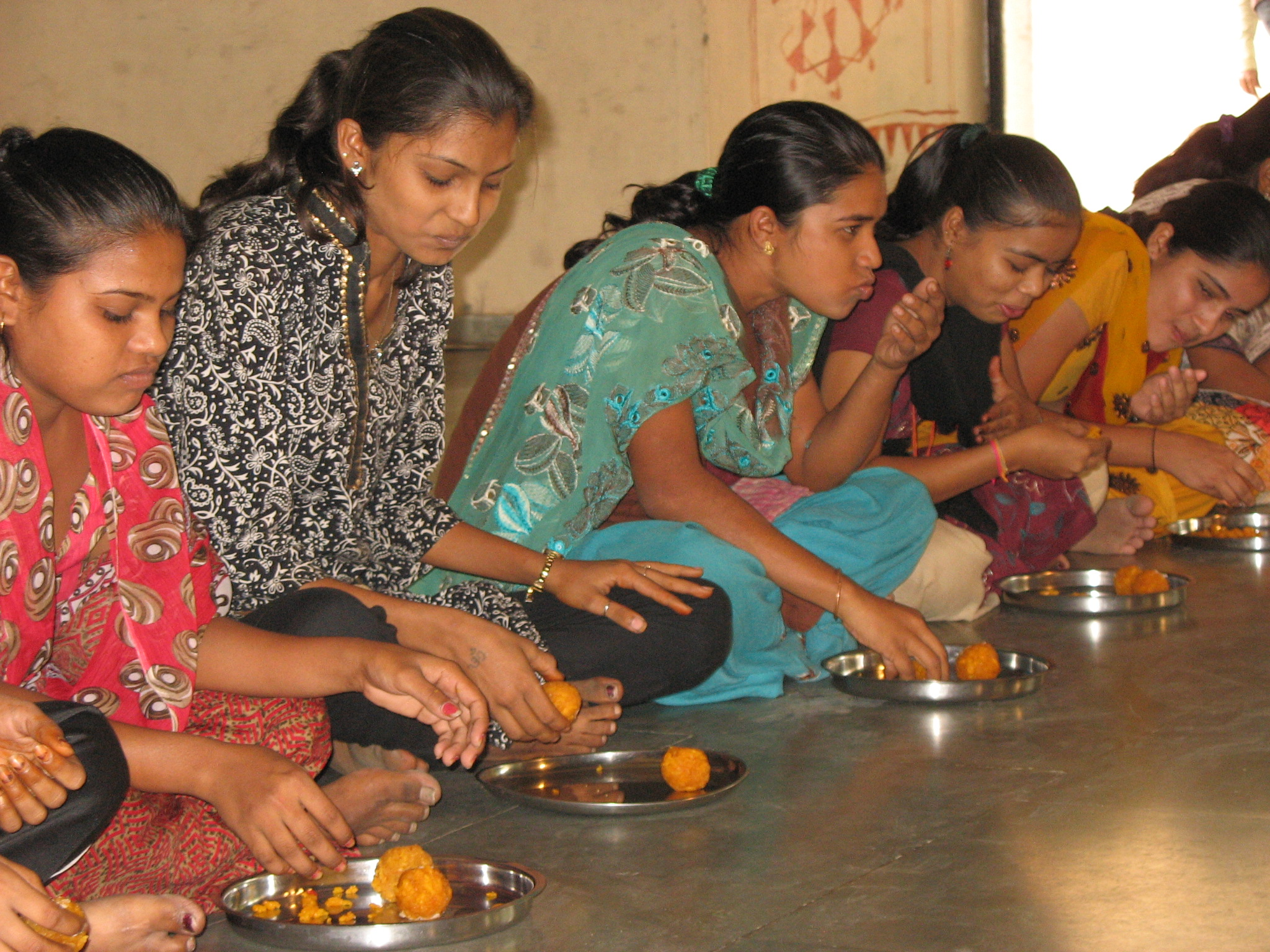 Dalit girls taking part in the sweet eating competition