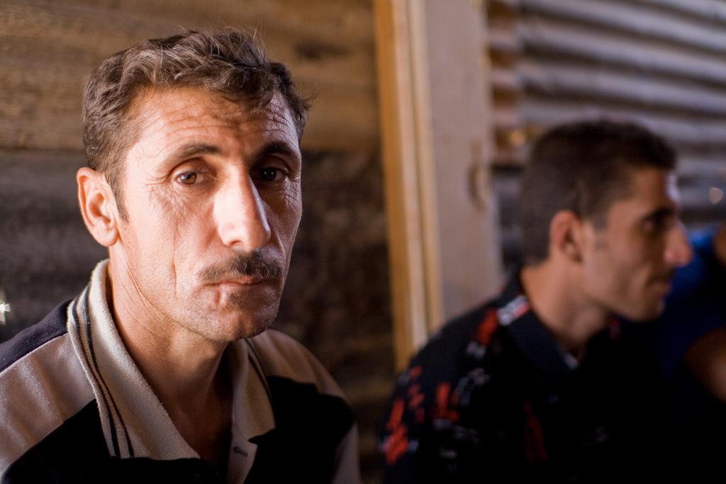 Iraqi Kurdish men in Syria