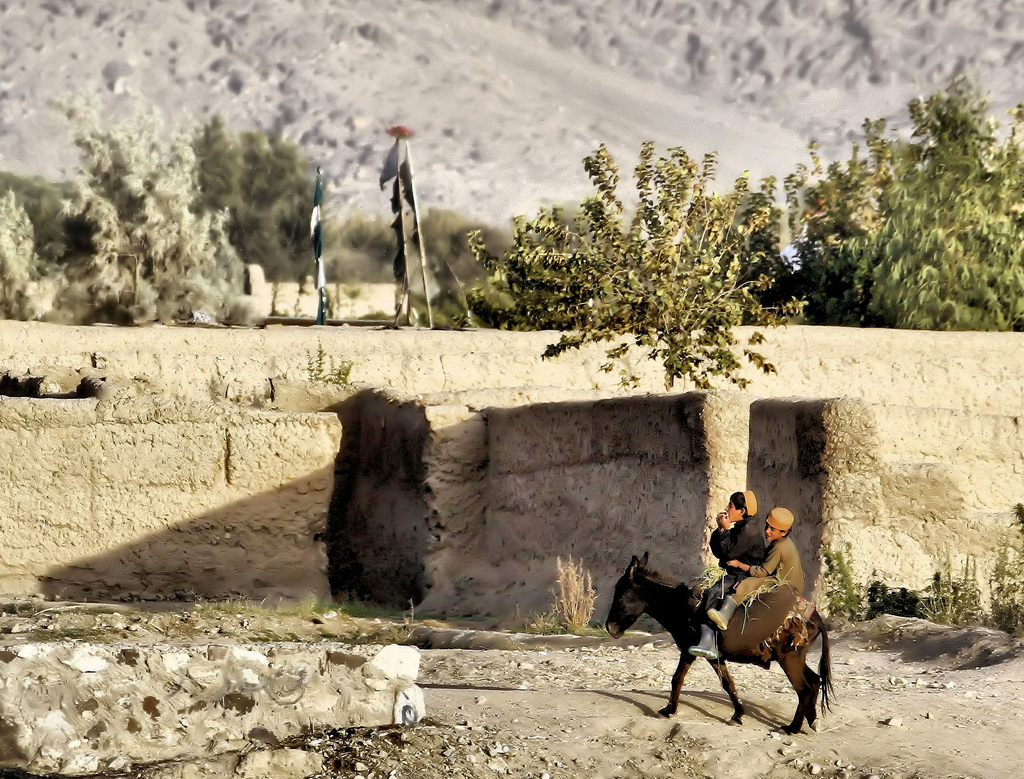 Iraqi Kurds ride a donkey in Iraqi Kurdistan
