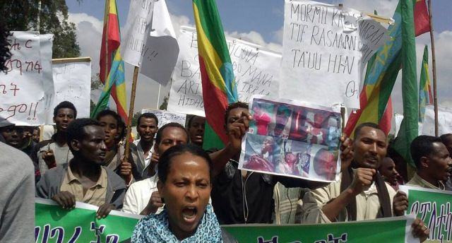 Protesters in Addis Ababa  demand TPLF to stop evicting Oromo farmers and grabbing their land, May 2014. Credit: Gadaa.com