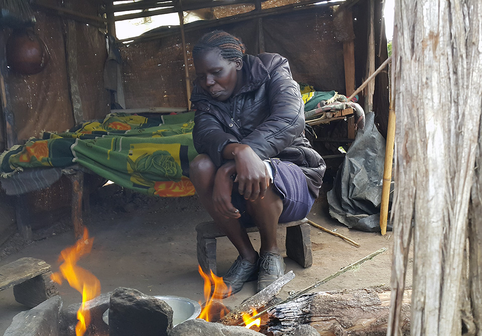 A member of the Sengwer community by the fireplace.