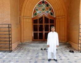 A man stands outside a Catholic church in Peshawar, Pakistan.