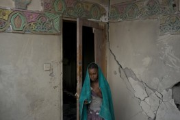 A girl from Yemen's marginalized class, the Muhamasheen, stands in the remains of her home after it was hit by an airstrike in San''a, Yemen. Credit: Alex Kay Potter
