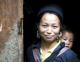 23 June, 2011 - Sapa, Vietnam - A H'mong woman and her baby in Sin Chai hill tribe village: Worldwide there has been remarkable improvement.  Since 1960, the number of children who die before age five has fallen by more than half.  (UNICEF) Photo Credit:Kibae Park/UN Photo