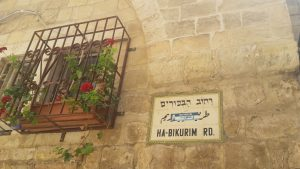 An Israeli election sticker covers the Arabic words on a street sign in the Jewish Quarter.