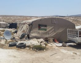 A cluster of tents are placed together in the village of Susya.