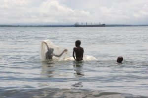 Afro-Colombian children swimming in the sea in Buenaventura.