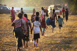 Ethnic Rakhine displaced by violence caused by the AA and the Tatmadaw arriving in a camp in 2018